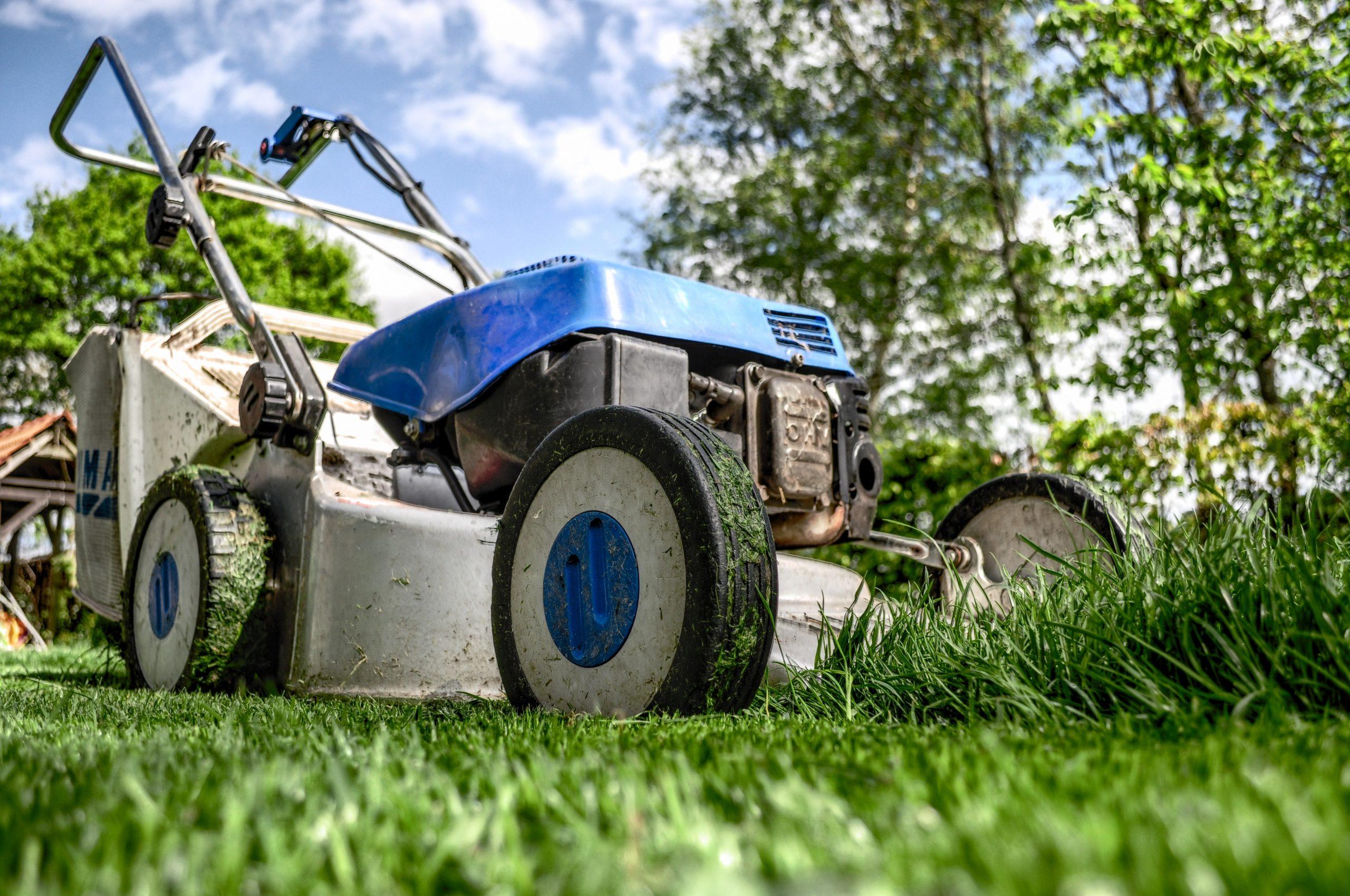 Regular Lawnmower Maintenance - Osburn Home Services - Paint Covered Overalls - Durham North Carolina