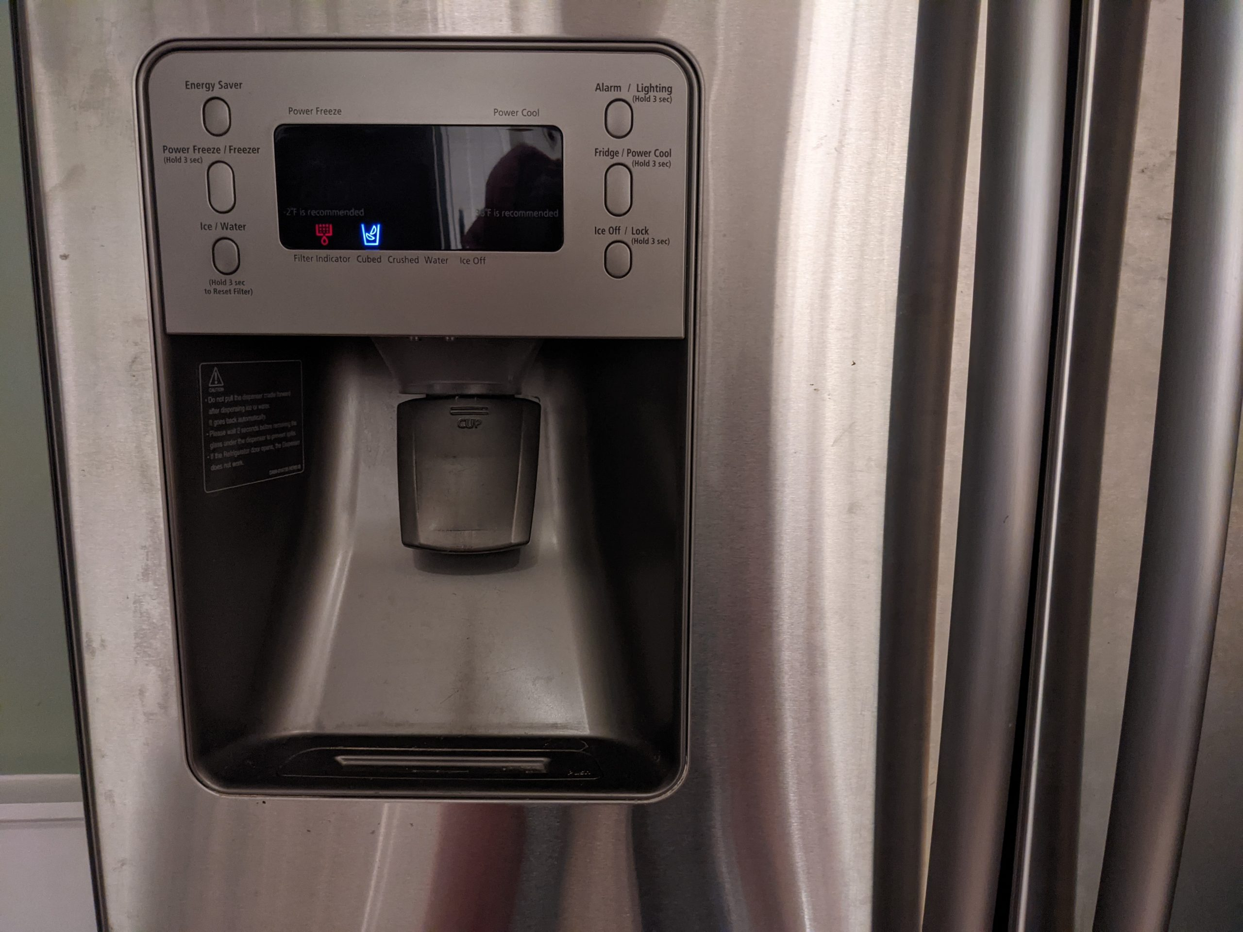 How to Clean your Fridge Water Dispenser - Paint Covered Overalls - Durham North Carolina